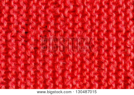 Close up the texture of knitted red cloth.