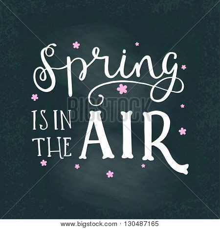 Vector lettering illustration. Spring is in the air. Calligraphy and lettering poster or postcard. Chalk board design. Spring lettering quote card. Concept composition on blackboard