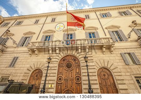 Spanish Embassy facade with its flying flag in Rome, Lazio, Italy.
