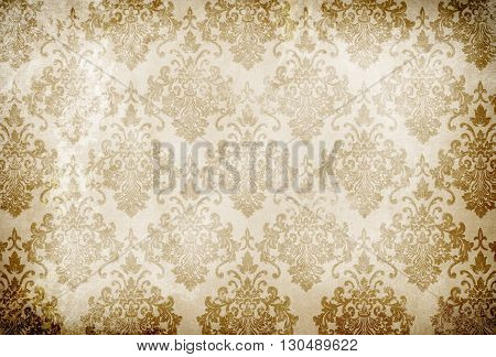 Old grunge paper background with old-fashioned floral ornament.