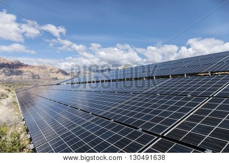 Solar panels with Mojave desert background at Red Rock Canyon National Conservation Area near Las Vegas, Nevada.