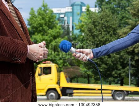 Journalist making interview with businessperson or politician