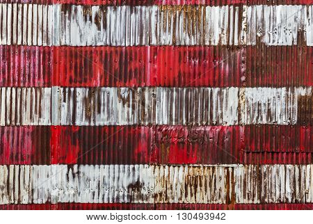Red And White Stripes Hand Painted On  A Rusty Fenc