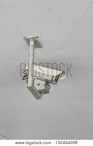 old security or surveillance cam cctv, hanging on ceiling