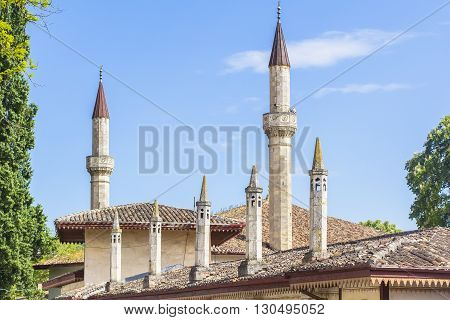 background landscape view over the rooftops and minarets of the old Khan's Palace in Bakhchisaray, Crimea