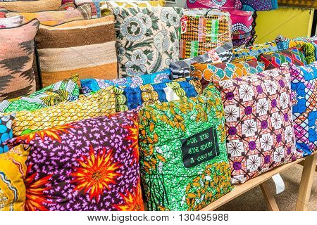London United Kingdom - May 14 2016: Brixton Village and Brixton Station Road Market. Colorful and multicultural community market run by local traders in South London. Colourful cushions