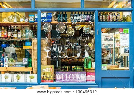London United Kingdom - May 14 2016: Brixton Village and Brixton Station Road Market. Colorful and multicultural community market run by local traders in South London. Bar window with list of drinks