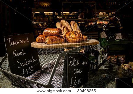 London United Kingdom - May 14 2016: Brixton Village and Brixton Station Road Market. Colorful and multicultural community market run by local traders in South London. French pastries