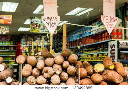 London United Kingdom - May 14 2016: Brixton Village and Brixton Station Road Market. Colorful and multicultural community market run by local traders in South London. White yum and yellow yum