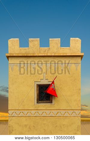 Stylised Moroccan flag in window of a typical property in Morocco.