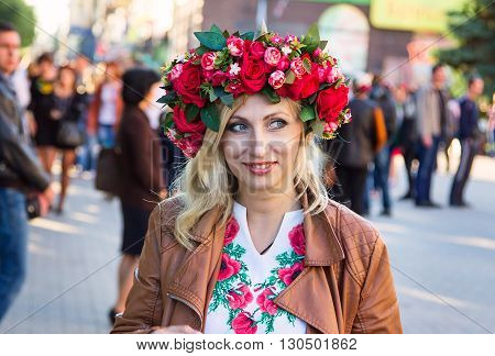 Zaporizhia/Ukraine- May 19, 2016: Beautiful smiling Ukrainian woman wearing flower wreath  during  celebration of traditional Ukrainian embroidered clothes, known as vyshyvanka  day, celebrated in all regions of Ukraine every third Thursday of May