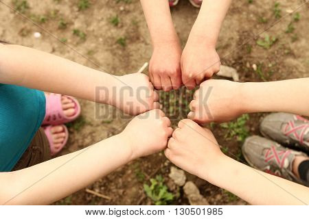 a maby  hands a group of children