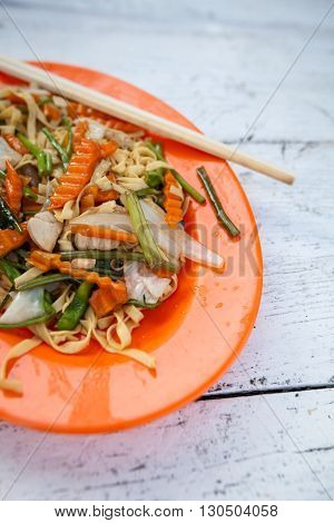Stir fried egg noodles with chicken. Traditional khmer cuisine.