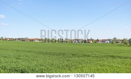 sunny illuminated idyllic rural springtime scenery including a small village in Hohenlohe a district in Southern Germany