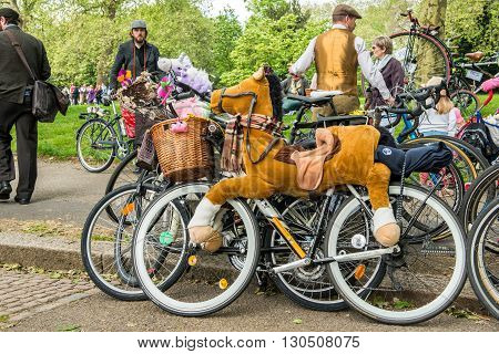 London United Kingdom - May 14 2016: Tweed Run (bicycle ride with a style) at picnic near Albert Memorial in Kensington Gardens Hyde Park. Bicycle dressed as a horse