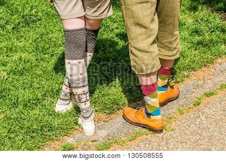 London United Kingdom - May 14 2016: Tweed Run (bicycle ride with a style) at picnic near Albert Memorial in Kensington Gardens Hyde Park. Colourful socks