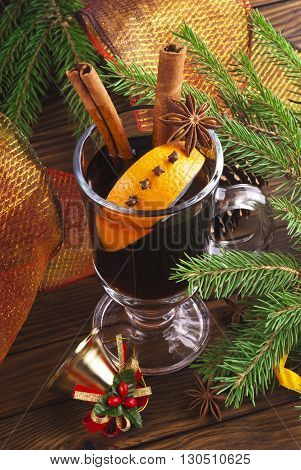 Hot spiced mulled wine garnished with orange.