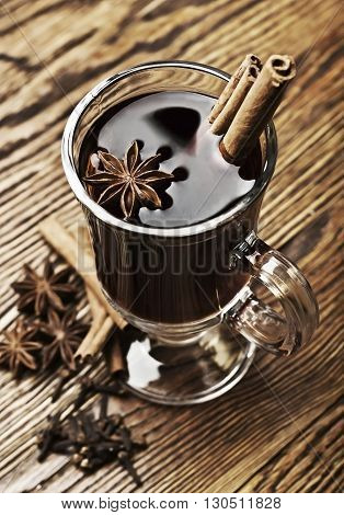 Christmas mulled wine on a wooden background.