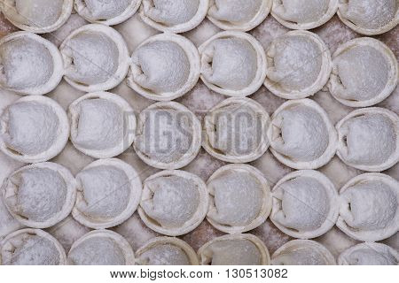 Frozen russian crude pelmeni as a food background or texture. Close up