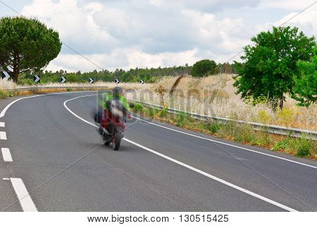 Motorcycle Motion Blur on the Winding Asphalt Road in Sicily
