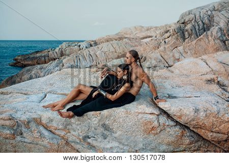 Attractive tribal style man and woman in ethnic jewelry outdoors