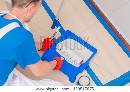 Preparing For Walls Painting Work. Men Preparing Painting Equipment. Professional Caucasian Painter.