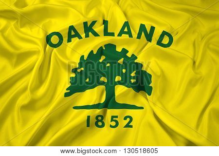 Waving Flag of Oakland California, with beautiful satin background, with beautiful satin background