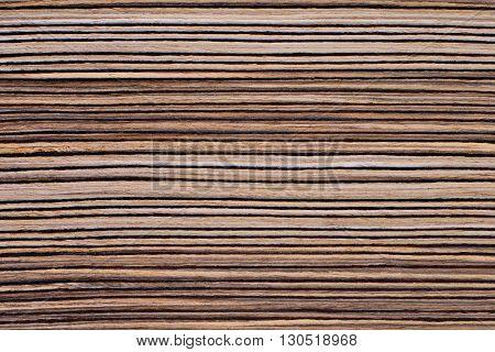 Texture of rich grain striped zebrano veneer