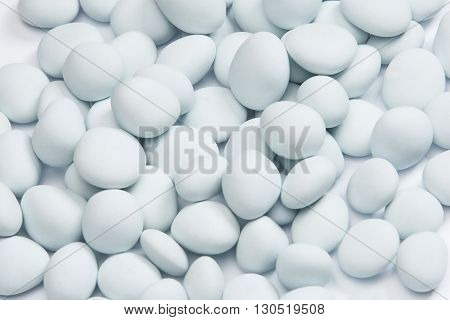 Large bunch of white sweet candy background - studio shot
