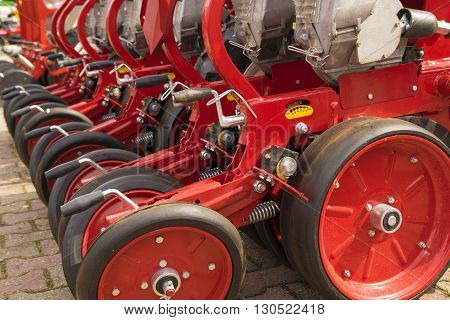Red seeder machinery for a Farming Tractor