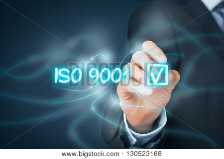 ISO 9001 - quality management system. Businessman click on button with ISO 9001 - certification concept.