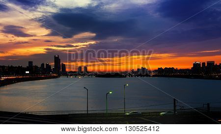 Silhouette cityscape at Han river and beautiful sunset in seoul South Korea.(Dark tone)