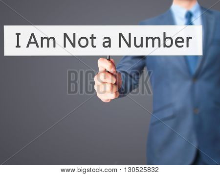 I Am Not A Number - Businessman Hand Holding Sign