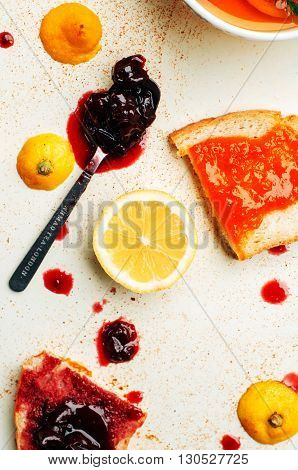 Homemade sandwiches with peach and cherry jam on a white background. It is decorated with fir branches. Butter and Jelly Sandwich. Flat lay.
