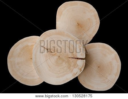 The composition of the four saw cut alder on a black background. Upper saw cut with crack.