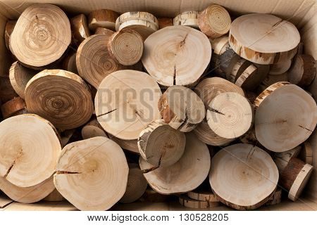 A pile of wooden saw cut alder, birch and pine in a cardboard box