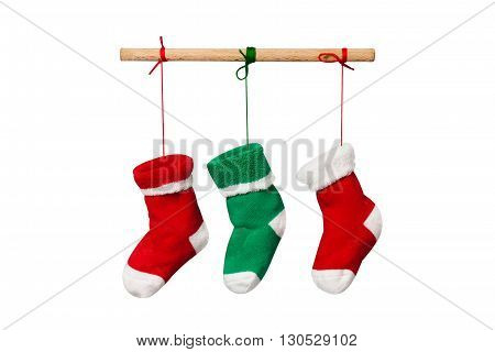 Hanging Christmas socks isolated on white background. Colorful christmas stocking decoration element. red and green knitted sock.