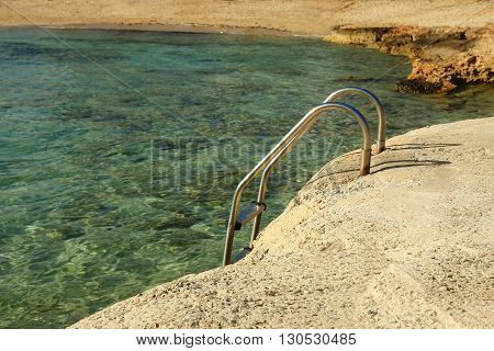 landscape from the sea with stairs to the shore background