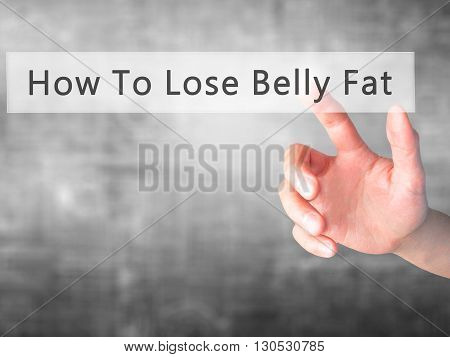 How To Lose Belly Fat - Hand Pressing A Button On Blurred Background Concept On Visual Screen.