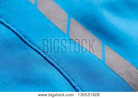 Blue coat textile texture with seam, close up