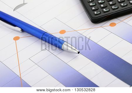 Business still life with pen and calculator