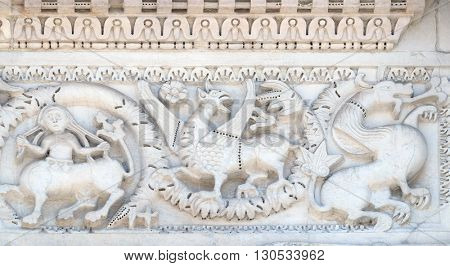 LUCCA, ITALY - JUNE 06, 2015: Bass relief on the Portal of San Michele in Foro Church in Lucca, Italy, on June 06, 2015