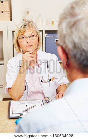Doctor listening to patient in the office during consultation