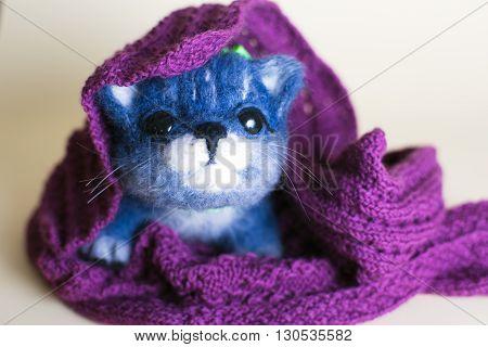 Funny handmade felt cat. Cute kitten toy
