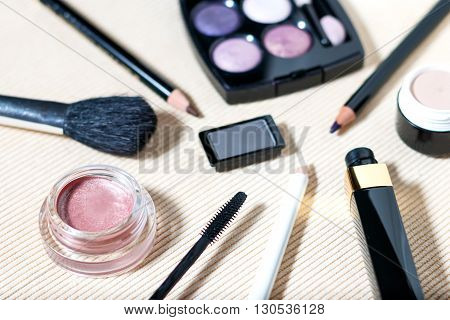 Makeup set of smokey eyes eyeshadow palette, brow powder, mascara, primer, eye pencils, selective focus