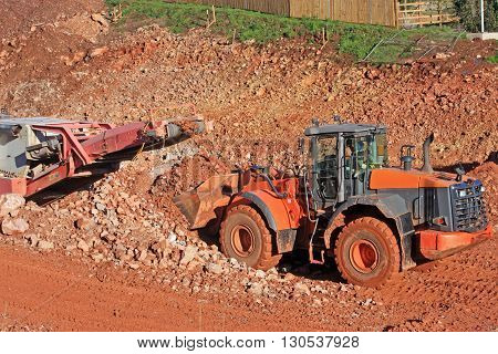 Front loader and stone crusher on a construction site