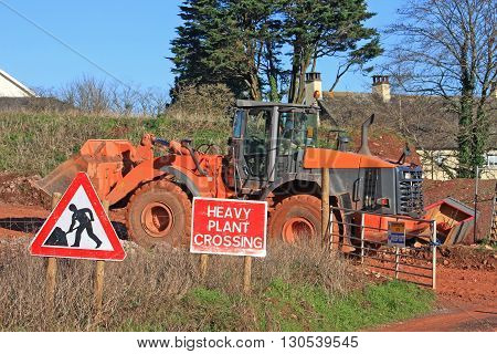 Front loader driving on a road construction site
