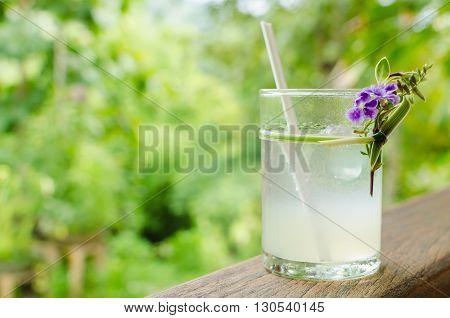 Cold fresh lemon juice on the wood rail.