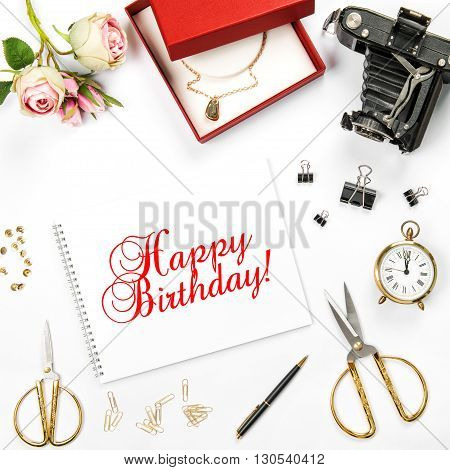 Birthday flat lay background with gift box and rose flowers. Sample text Happy Birthday! Greetings card concept