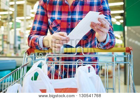 Woman Housewife Looking Check In Store